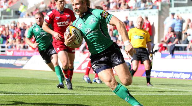 Connacht's Fionn Carr, here running in for a try against Scarlets on Saturday, has entered the frame for a call-up to Declan Kidney's Irish squad.