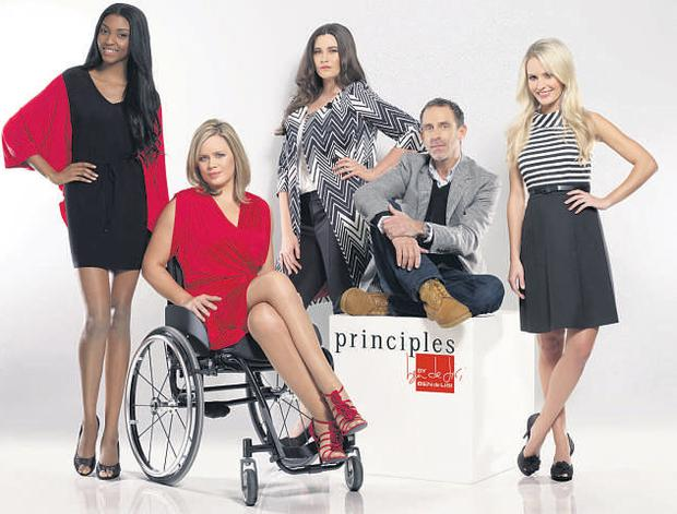 Shannon pictured right, along with designer Ben de Lisi and other models