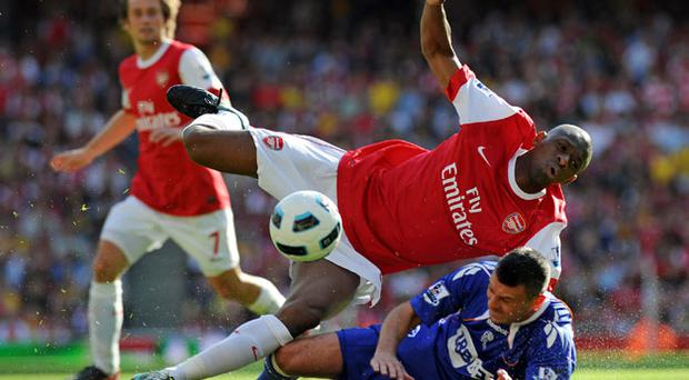 Arsenal midfielder Abou Diaby is set to miss the Champions League match against Braga after a high tackle by Bolton defender Paul Robinson Photo: Getty Images