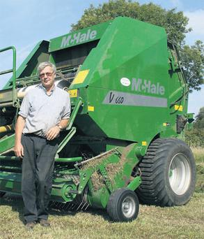 John Howlin shows off his V660 variable-chamber belt baler