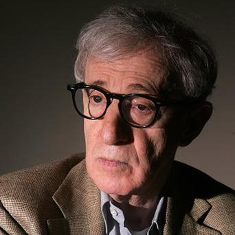 Woody Allen said he was delighted with Carla Bruni-Sarkozy