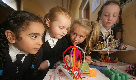 Students St Catherine's First Class look at their scary sea monsters at a school exhibition