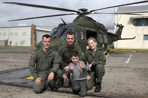 Six-year-old Conor Reidy meets (left to right) aircrew members David Tiernan and Gerry Morgan and Captain Anne Brogan. Photo: PA