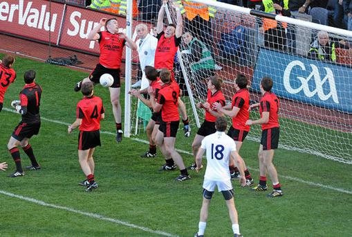 GRAND FINALES: Kildare's last minute free is tipped onto the crossbar as Down sneak into the All-Ireland football final after the dramatic conclusion to their semi-final.