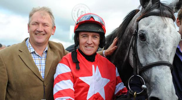 Alpha Beat with trainer Charles Byrnes and jockey Barry Geraghty after winning the Kerry National at Listowel yesterday.