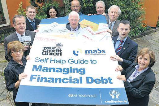 Staff from Chapter 23 Kerry Credit Unions and Kerry MABS (Money Advice and Budgeting Service) launching a self-help guide to managing debt in Tralee