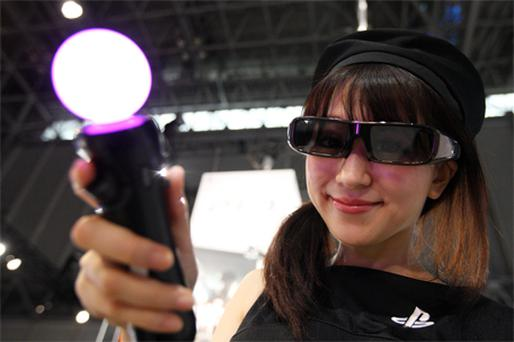 A model wearing 3D glasses shows off Sony's Playstation 3