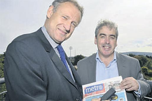 Colm Grealy, CEO of DRG, and Paul Crosbie, managing director of 'Metro Herald', have agreed a deal on QR codes