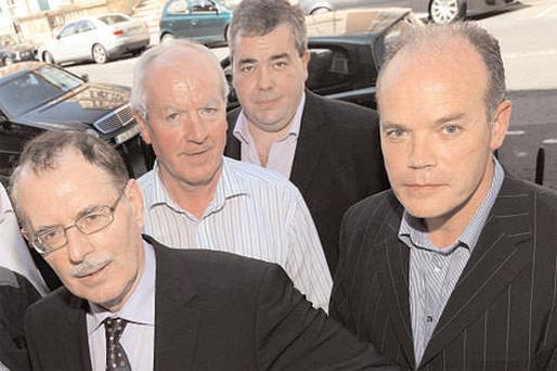Concerned Irish Businesses (CIB) representatives, spokesman John Maguire, Gerry Reilly, Adrian Caffrey and Gerald O'Brien after a press conference in Buswells Hotel, Dublin, yesterday