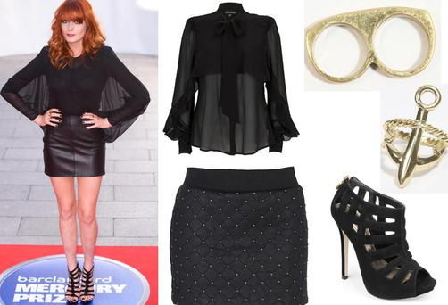 Black blouse Warehouse €60; Black skirt River Island €47; Anchor ring from Urban Outfitters €8; gold double ring Urban Outfitters €14; Buffalo shoes €120;