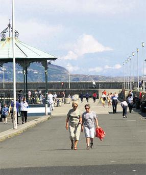 Walkers take a stroll down the East Pier in Dun Laoghaire