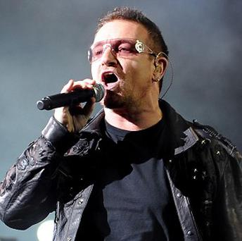 U2 frontman Bono has tried to persuade French president Nicolas Sarkozy to take action on poverty