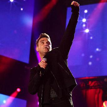 Robbie Williams has admitted miming to George Michael's version of Freedom