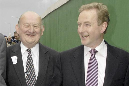 SUPPORTERS: FG leader Enda Kenny, right, told gardai to 'ignore the incident' with PJ Sheehan, TD, left