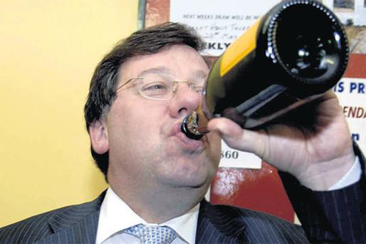CHEERS TO JEERS: Brian Cowen celebrates with champagne after winning his seat in the Laois/Offaly election count in 2007
