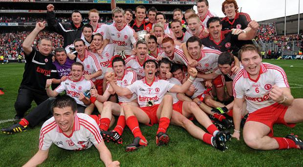 Tyrone's players celebrate after their thrilling victory over Cork in the ESB All-Ireland Minor Football Championship final.