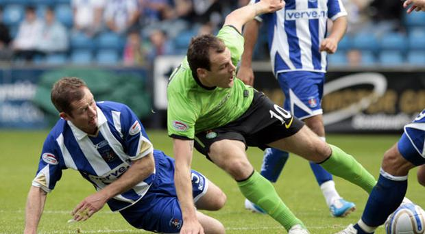 Anthony Stokes is down but not out as he battles for the ball with Kilmarnock's Frazer Wright at Rugby Park. Photo: PA