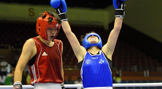 Katie Taylor celebrates her win over Cheng Dong of China in the lightweight final at the World Championships in Barbados.