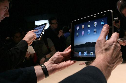 The virtual newsagent will be separate from Apple's App Store, where special iPad versions of some newspapers can already be downloaded. Photo: Getty Images
