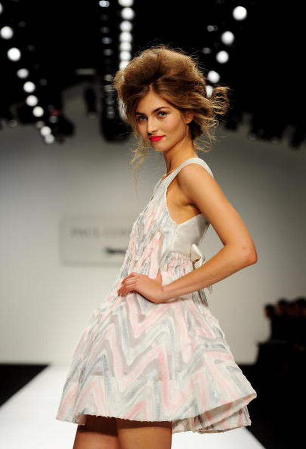 LONDON, ENGLAND - SEPTEMBER 17: A model walks the runway during the Paul Costelloe Spring/Summer 2011 fashion show during LFW at the Somerset House on September 17, 2010 in London, England. (Photo by Ian Gavan/Getty Images)