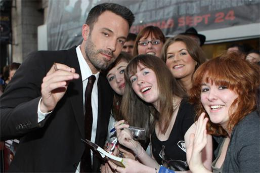 Ben Affleck signs autographs for fans outside the Savoy Cinema, Dublin, yesterday evening at the Irish premiere of his new film 'The Town'