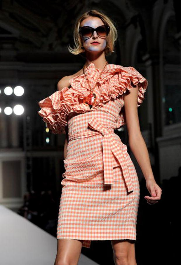 LONDON, ENGLAND - SEPTEMBER 19: A model walks the runway during the Vivienne Westwood Red Label Spring/Summer 2011 fashion show during LFW on September 19, 2010 in London, England. (Photo by Gareth Cattermole/Getty Images)