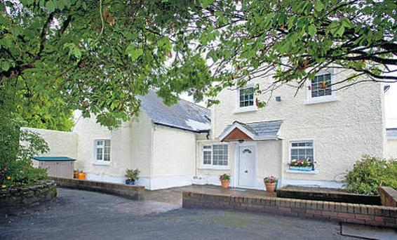 Included in the sale is this main residence, a gate lodge, 40ac, a stable yard and another yard