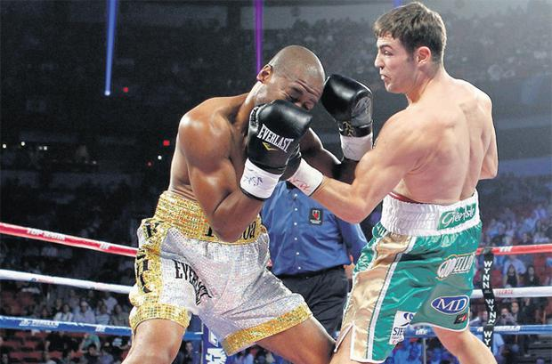 Matthew Macklin (right) lands a punch on Canada's Joachim Alcine on his way to an impressive victory in Las Vegas