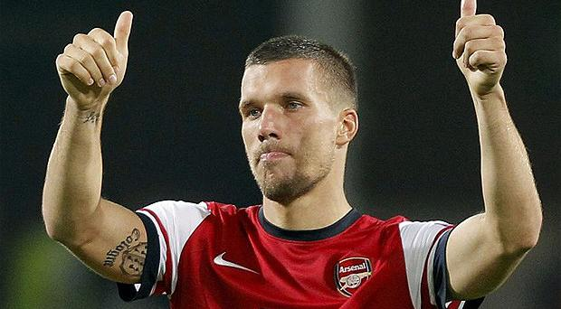 Ink-redible start: Lukas Podolski has made an instant impact at Arsenal. Photo: Reuters