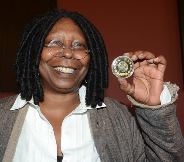 Whoopi Goldberg receives the Gold Honorary Medal of Patronage from Trinity College Philosophical Society, Dublin, on September 19th 2012.
