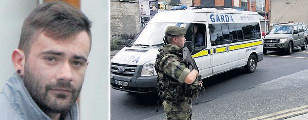 Vincent Ryan (left), brother of slain dissident Alan, being brought to the Special Criminal Court yesterday