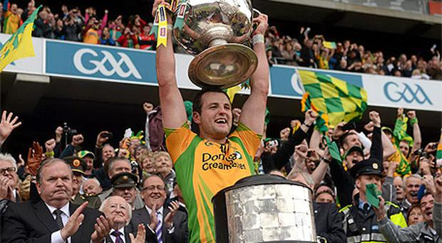 Donegal captain Michael Murphy lifts the Sam Maguire cup
