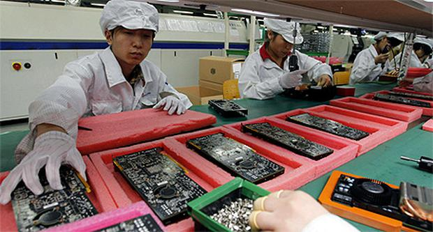 Workers on the production line at Foxconn