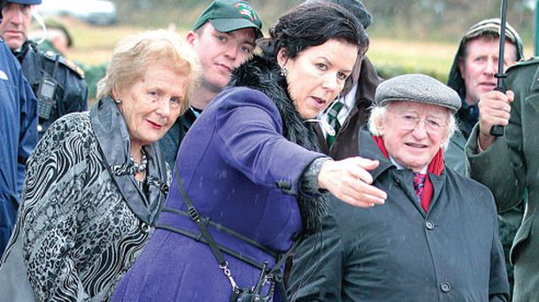 Anna May McHugh and daughter Anna Marie McHugh with President Michael D Higgins at the Ploughing Championships in New Ross this week