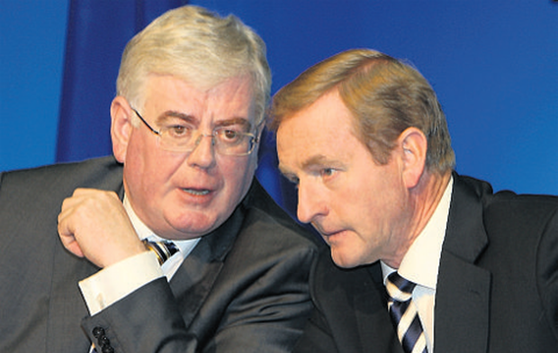Eamon Gilmore, left, was at the UN yesterday while Enda Kenny expressed his regret at Ms Shortall's decision.