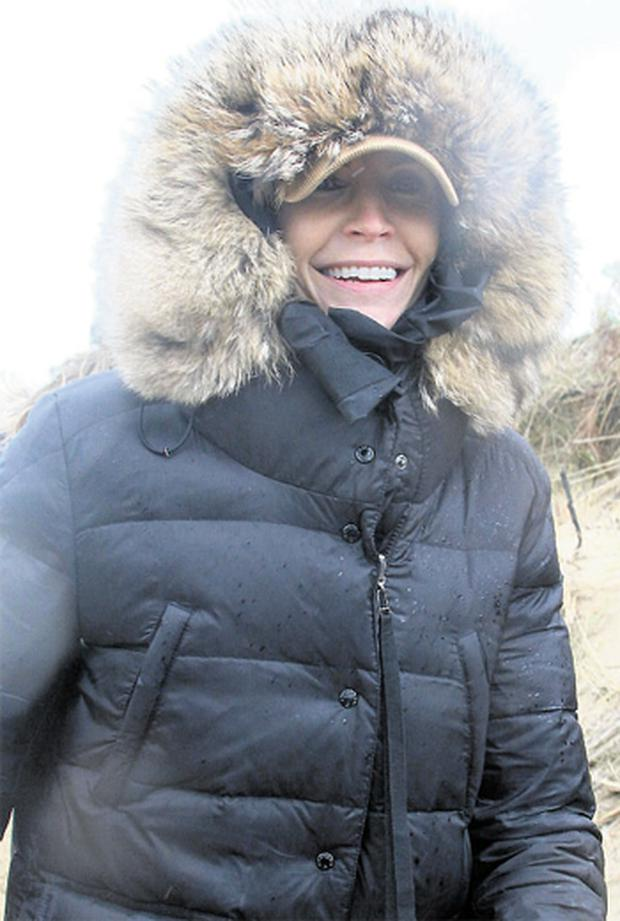 Yvonne Keating keeping covered up from the wind and rain