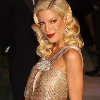 Tori Spelling still seems to be feeling the love despite infidelity rumours.