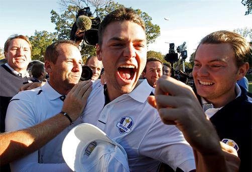 Martin Kaymer celebrates winning his match against US golfer Steve Stricker to retain the Ryder Cup