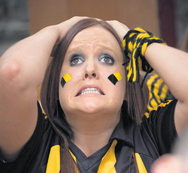 Cats fan Emma Breslin endures a tense moment in the All-Ireland Senior Hurling Championship final as she watches the match in Kyteler's Inn, Kilkenny city.