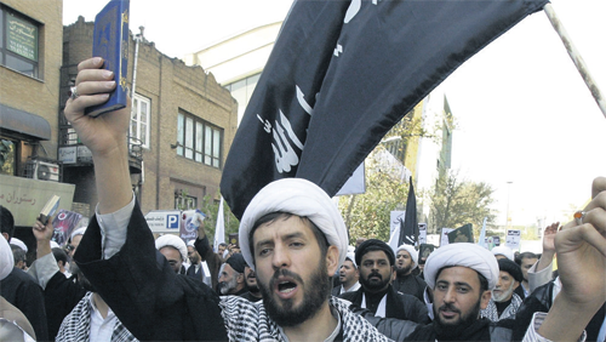 Iranian clerics hold copies of the Koran at a demonstration in Tehran.