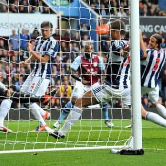 Darren Bent, centre, scored Aston Villa's equaliser to claim a point against West Brom
