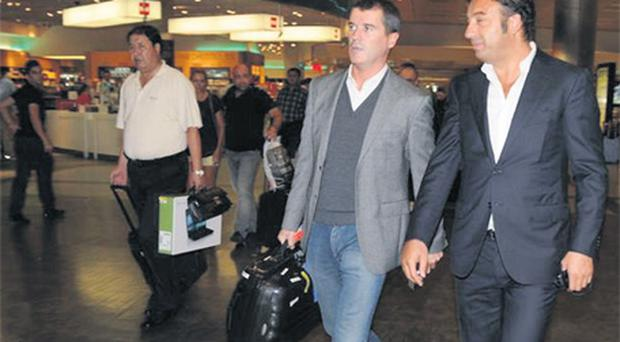 Roy Keane and an official from the Kasimpasa club in Istanbul Airport