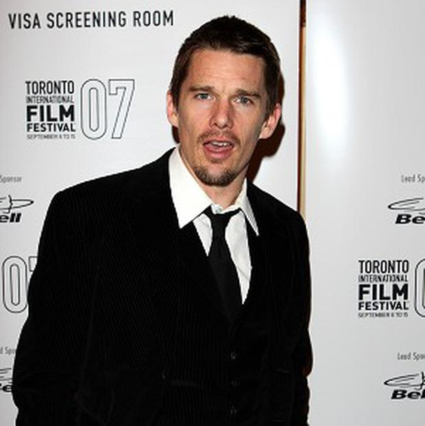 Ethan Hawke co-stars with Julie Delpy in Before Midnight
