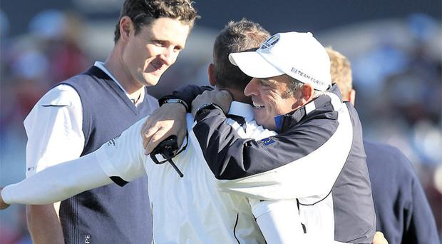 Paul McGinley celebrates with Justin Rose and Sergio Garcia at Medinah