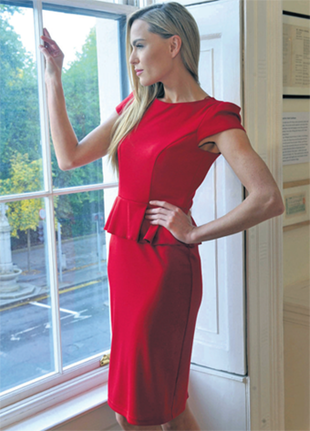 Sarah Morrisey modelled it in yuletide red yesterday at the launch of the Tesco autumn/winter 2012 collection at the Little Dublin Museum.