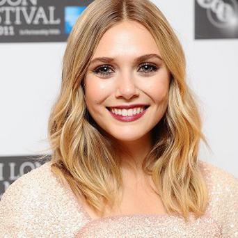 Elizabeth Olsen received a packet of crisps as a romantic gift from a past sweetheart