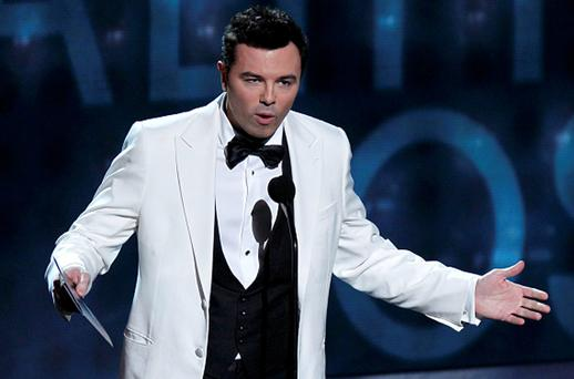 'Family Guy' creator Seth McFarlane presents the award for outstanding reality show host at the 64th Primetime Emmy Awards in Los Angeles. Photo: Reuters
