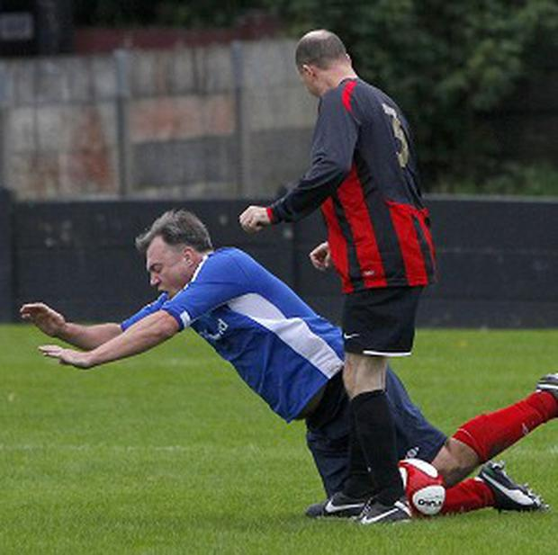 Shadow Chancellor Ed Balls is fouled at Salford City Football Club, Salford, during the Labour MPs Vs Press Lobby football match