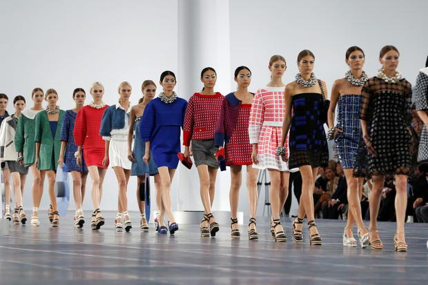 Models present creations by German designer Karl Lagerfeld for French fashion house Chanel as part of his Spring/Summer 2013 women's ready-to-wear fashion show during Paris fashion week October 2, 2012. REUTERS/Charles Platiau (FRANCE - Tags: FASHION)