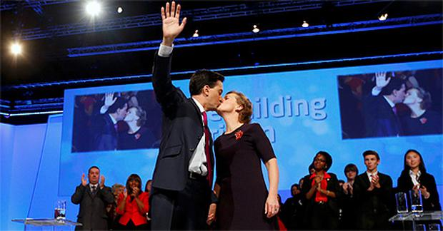 Britain's opposition Labour Party leader Ed Miliband kisses his wife Justine on stage after delivering his keynote speech at the party's annual conference in Manchester